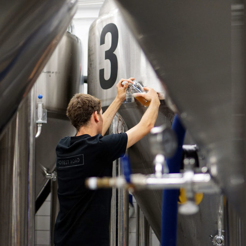 James, a brewer at Beerbliotek, taking a sample of PILS PLS, a new Pilsner brewed during 2018 at their Kungssten brewery.